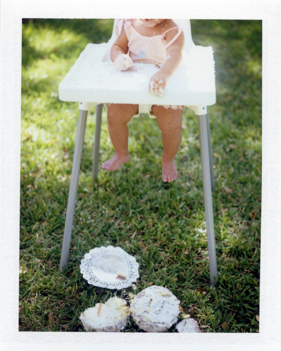 Playful baby dropping cake  | Photographers who shoot film