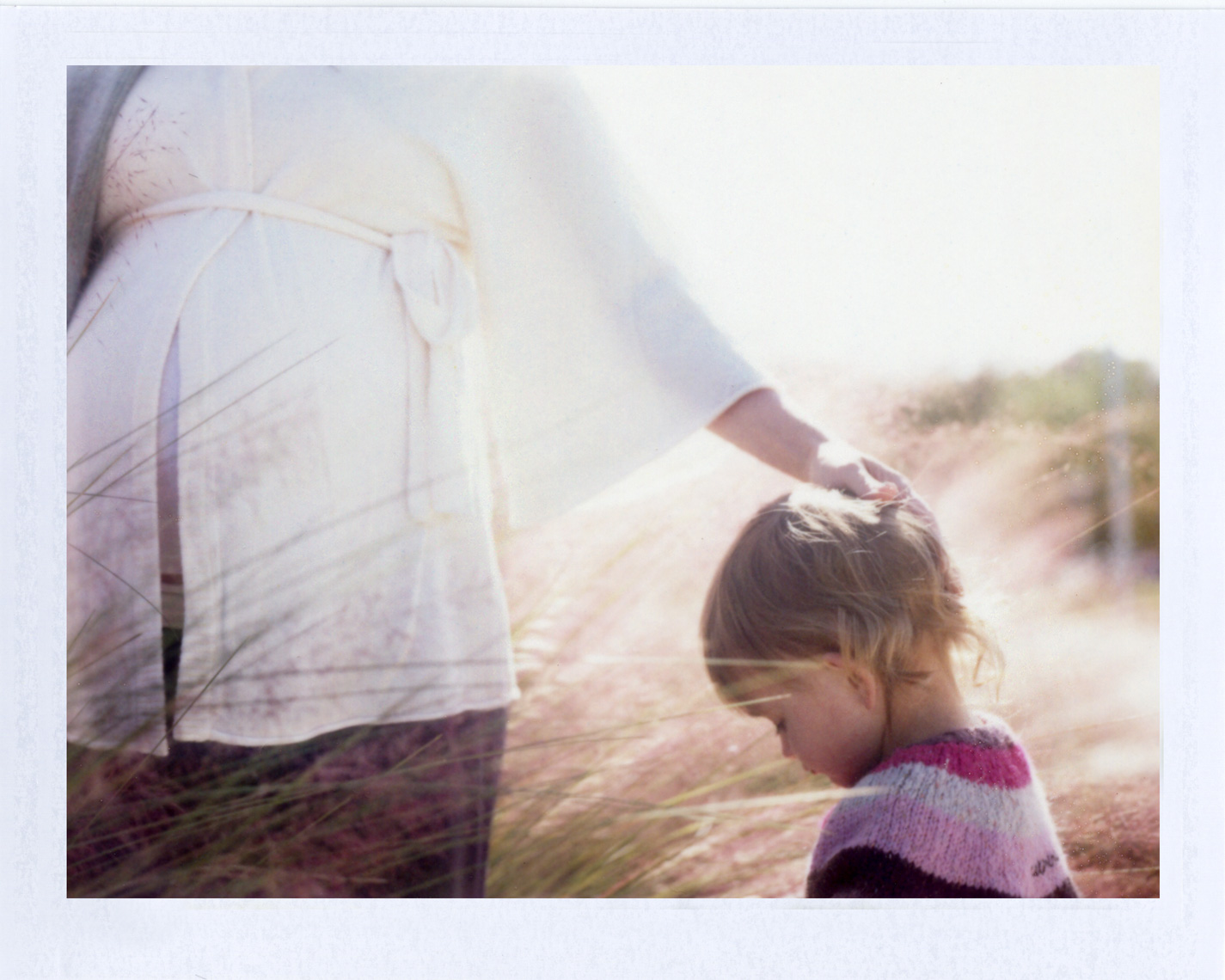 Pregnant mom and child | Photographer using Polaroid