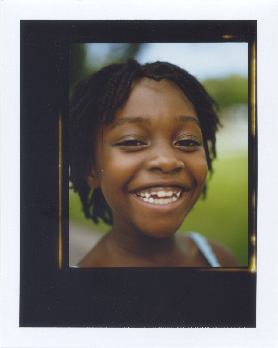 Joyful portrait of young girl shot on Polaroid | Tosca Radigonda Photography