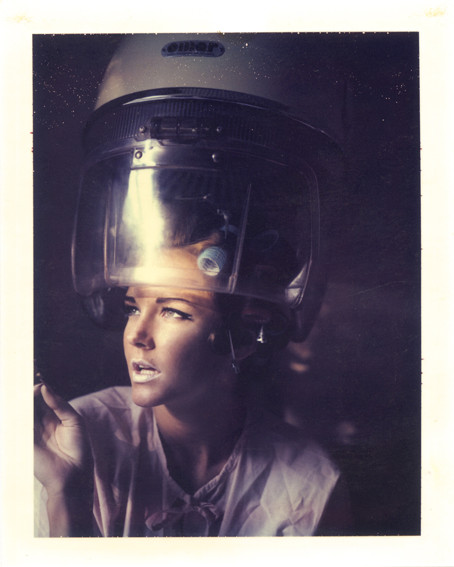 Whimsical woman under hair dryer | Polaroid Photographers