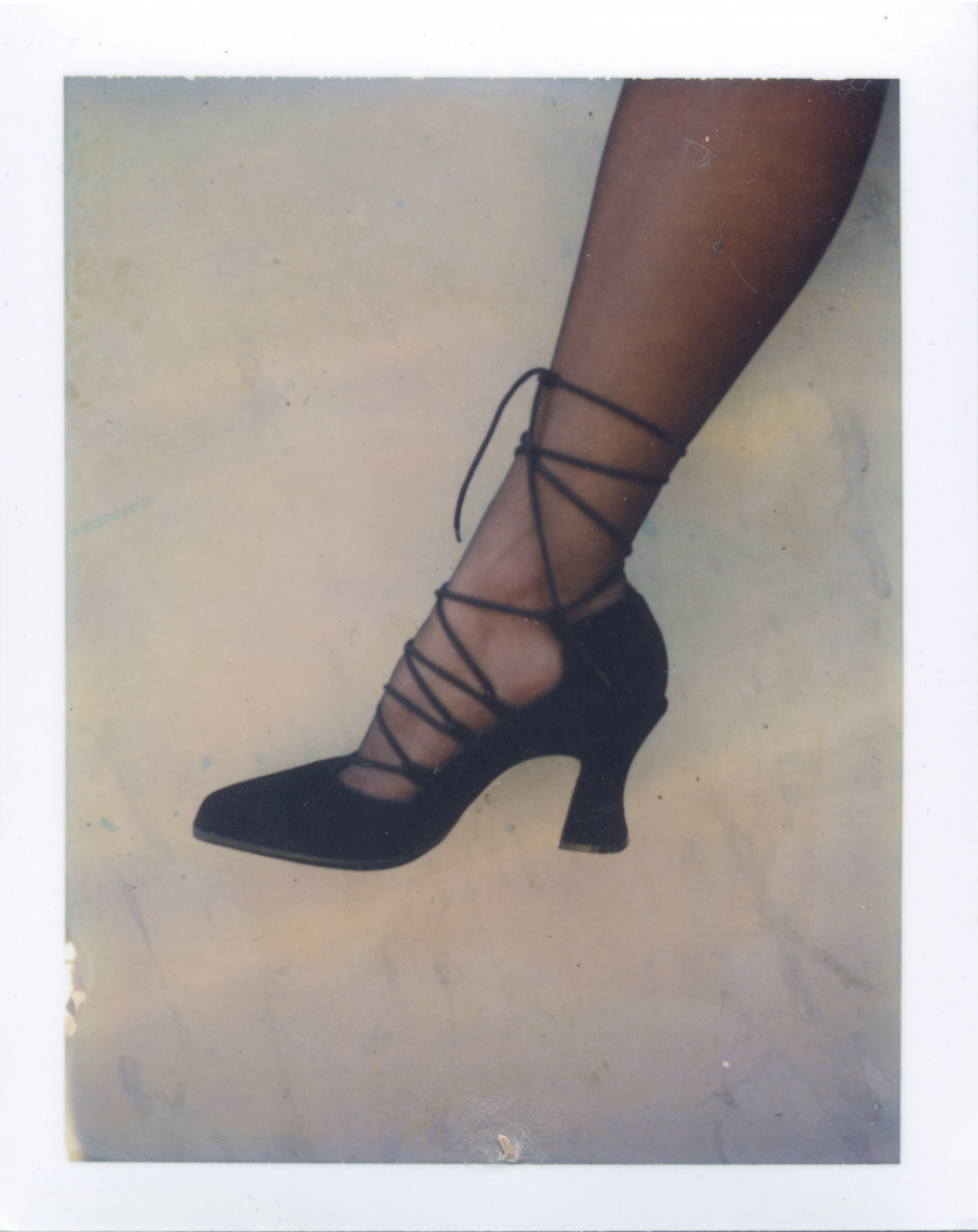 Profile of shoes shot | Polaroid Photographers