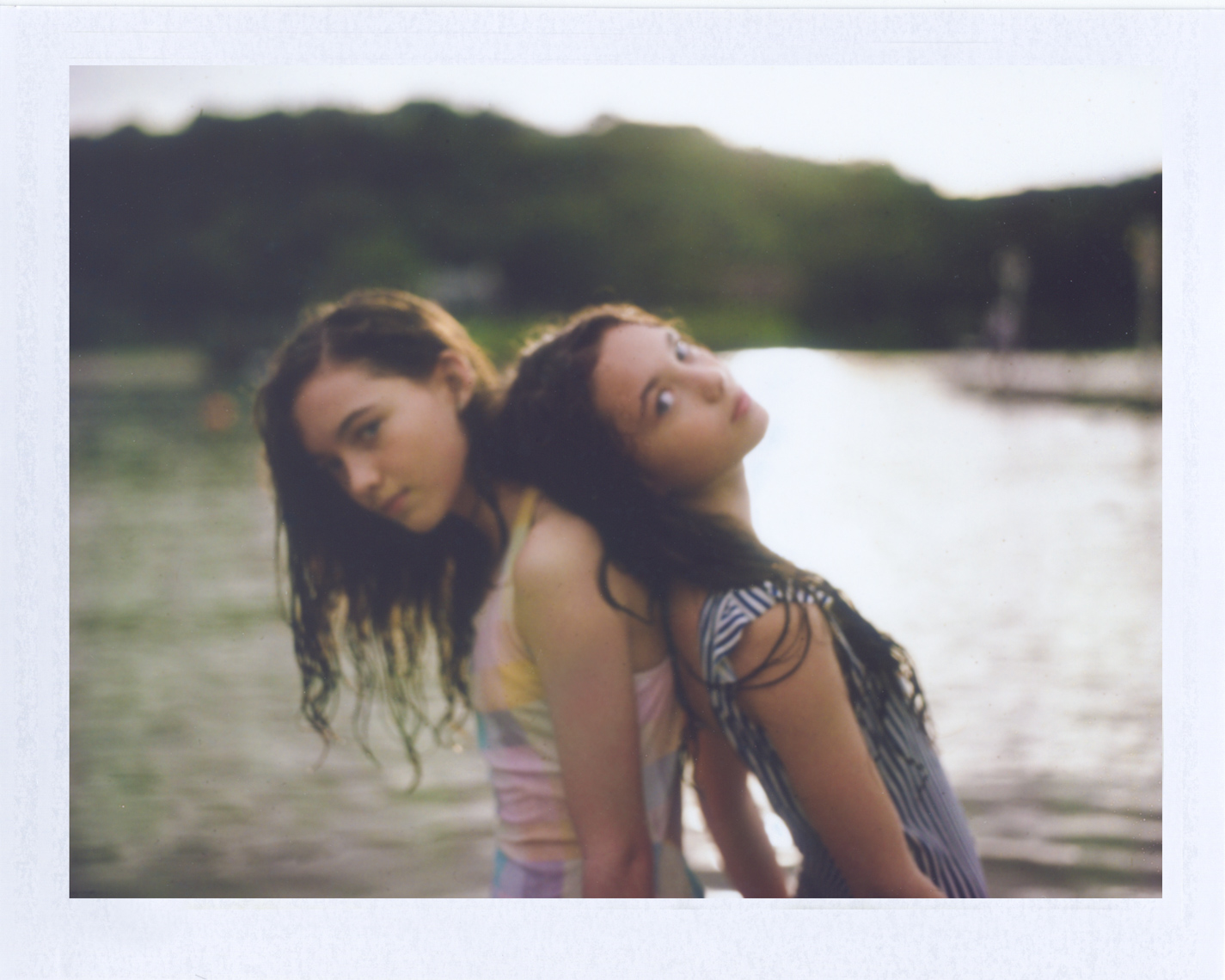 Twin girls at lake shot on Polaroid | Photographers who shoot film