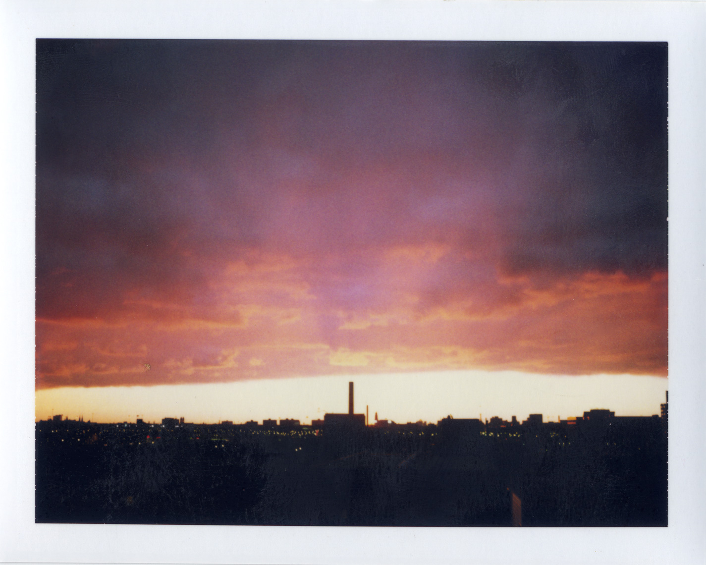 Purple orange Chicago sky shot on Polaroid