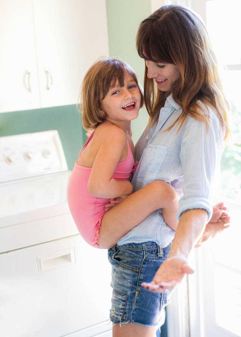 Hugging mom in laundry room | Commercial Lifestyle Photographer