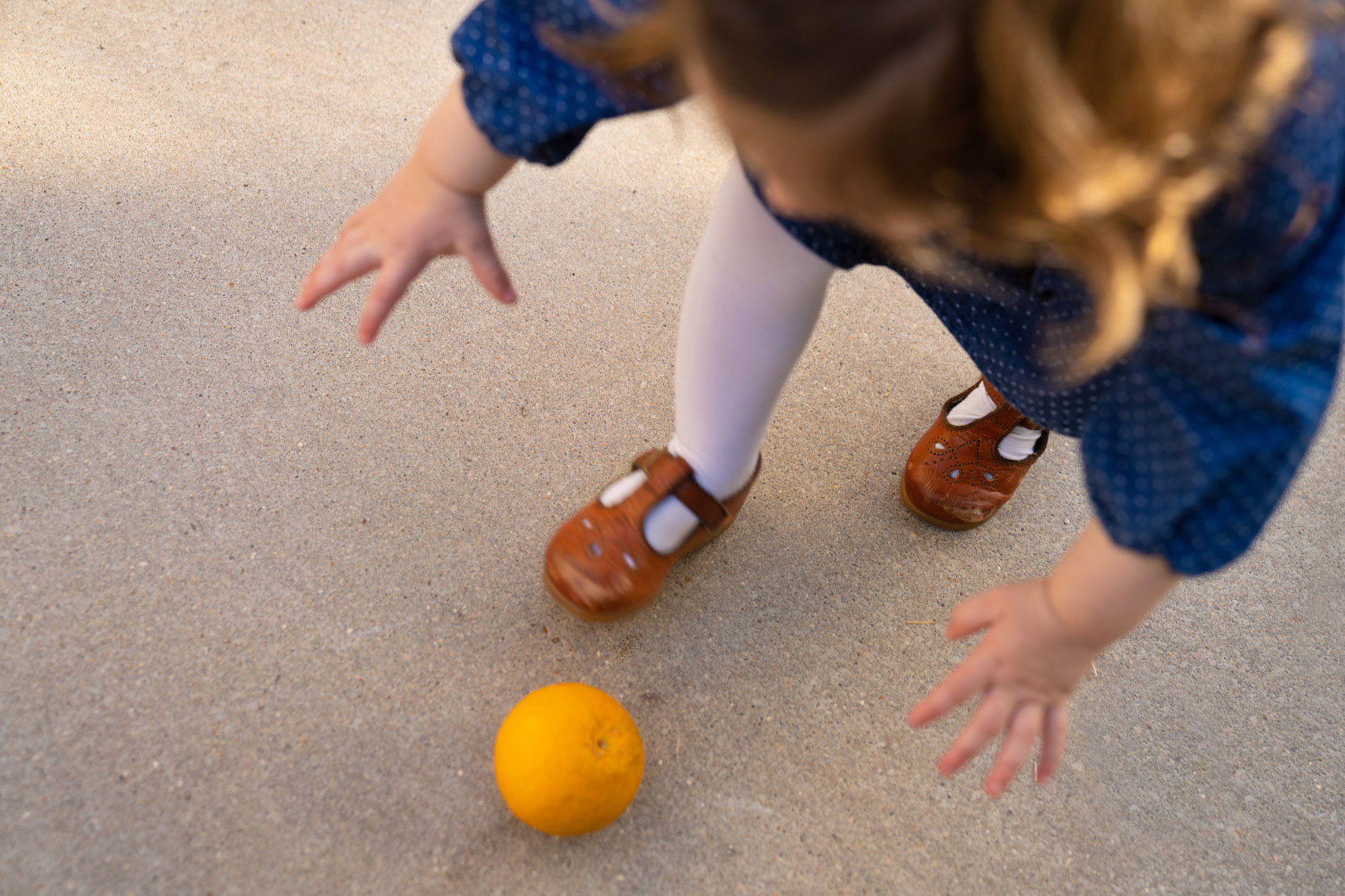 Child catching orange | Kids Lifestyle Photographer
