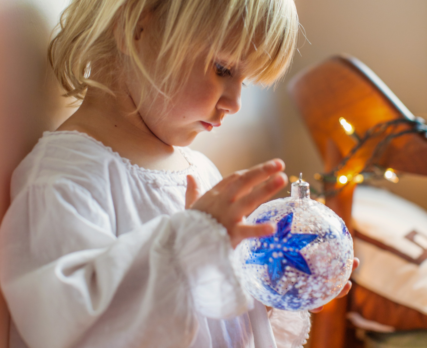 Young girl with Christmas ornament | Kids Lifestyle Photographer