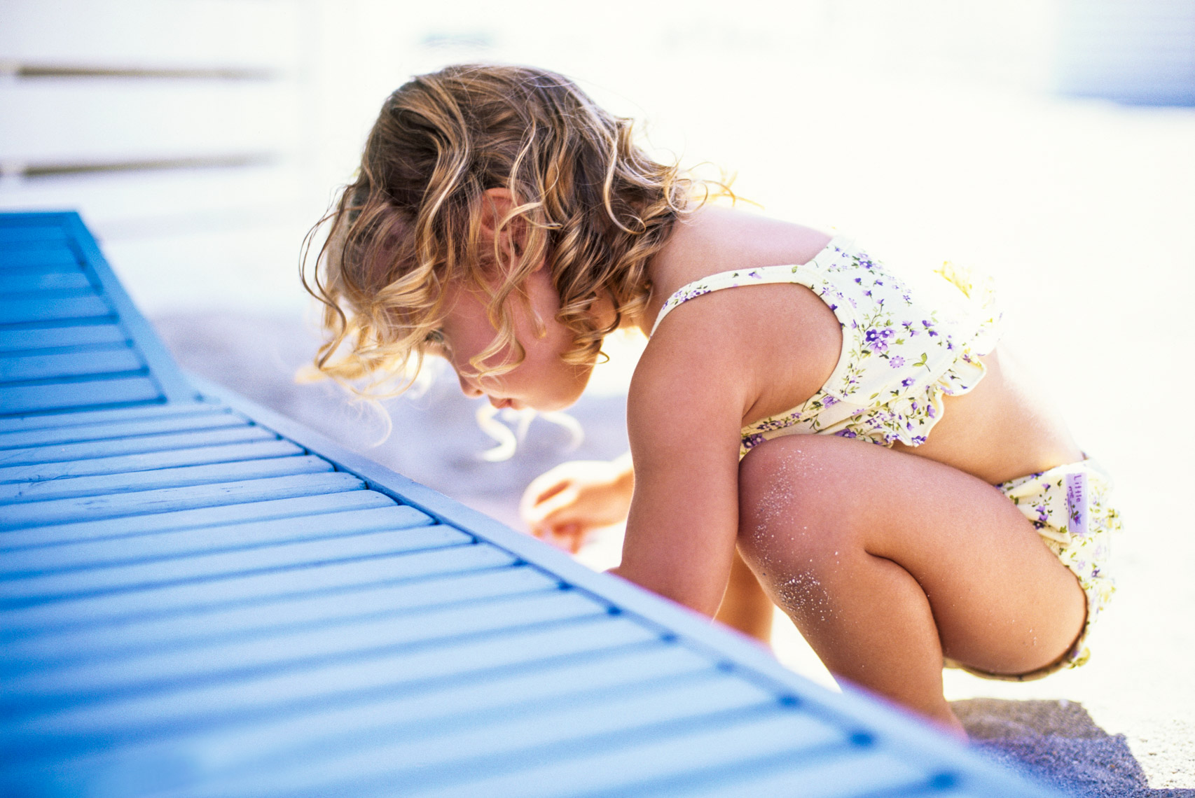 Curious child exploring beach | Kids Lifestyle Photographer