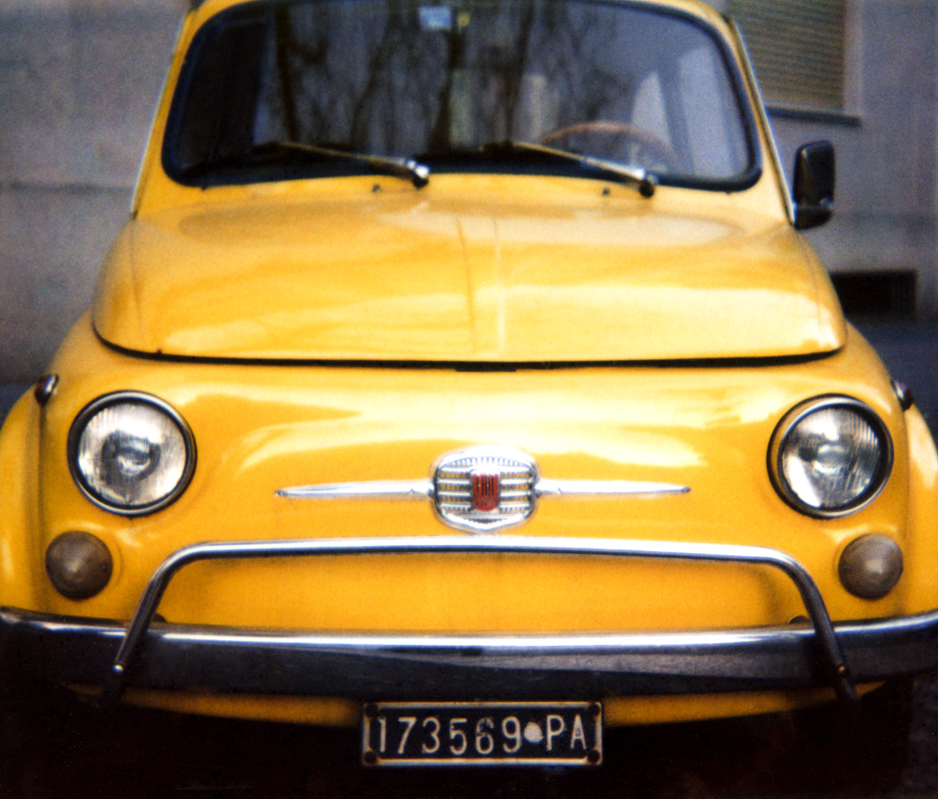 Image of yellow vintage Fiat 500 | Photographers using film