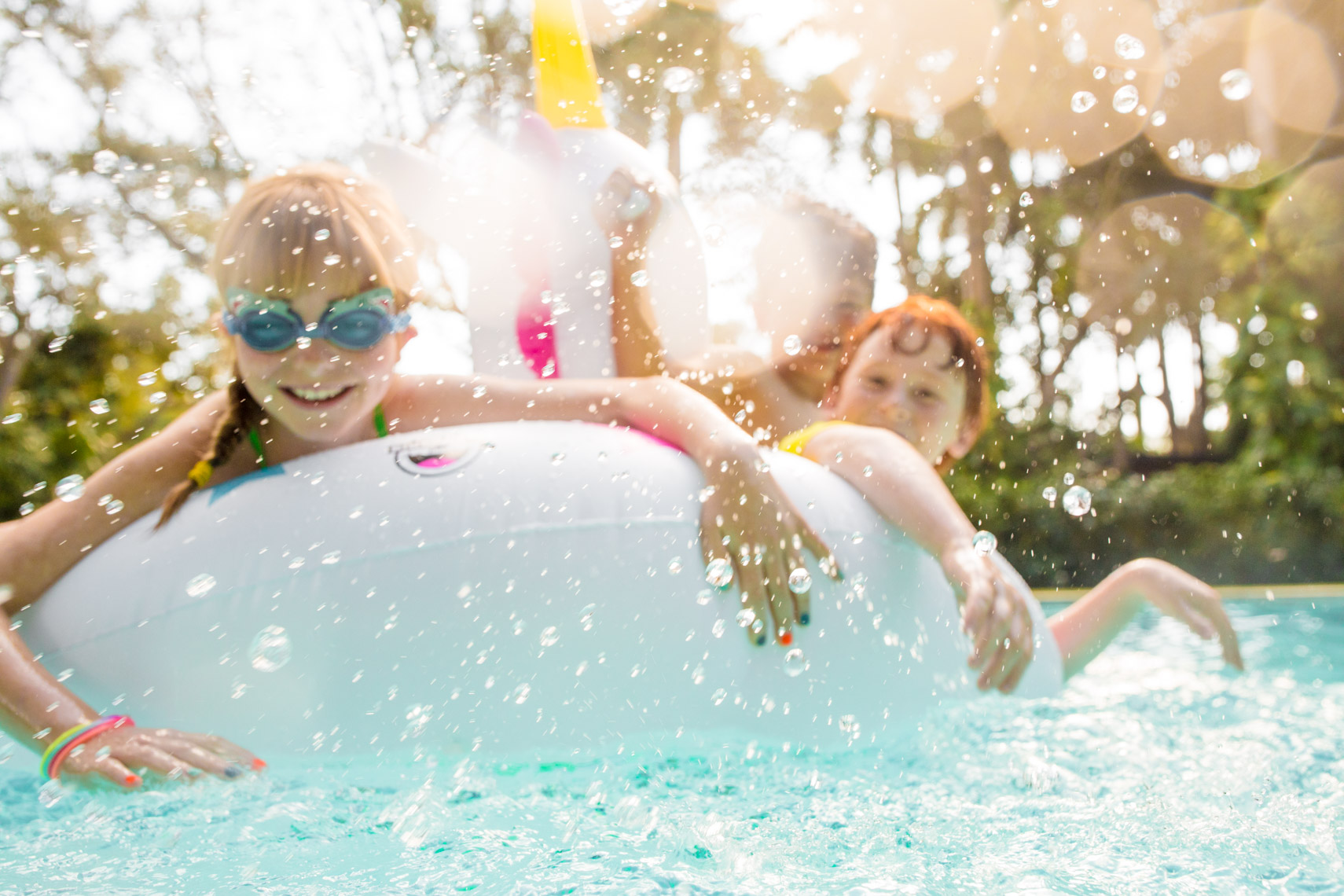Cheery kids on pool float | Commercial Lifestyle Photographer