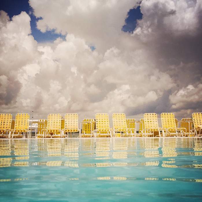 Miami pool under dramatic sky | Editorial Travel Photographer