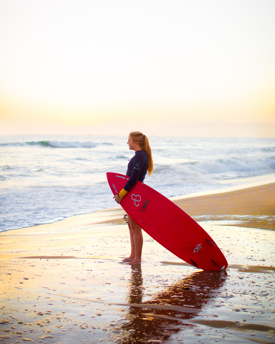 Surfer girl looking at ocean | Commercial Lifestyle Photographer